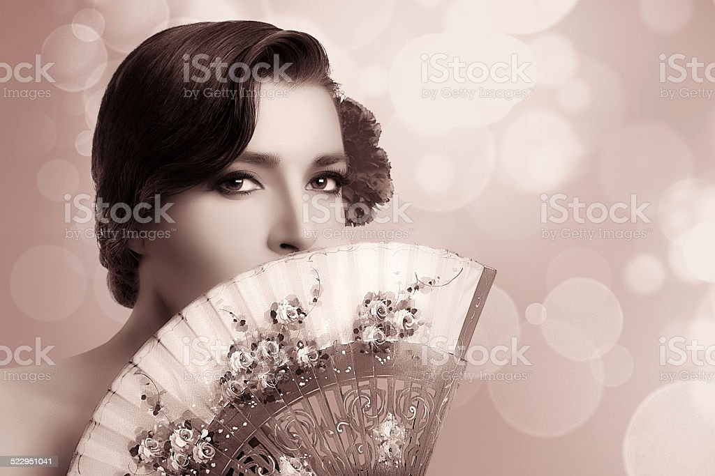 Gypsy Girl. Beauty Fashion Andalusian Woman with Stylish Fan stock photo