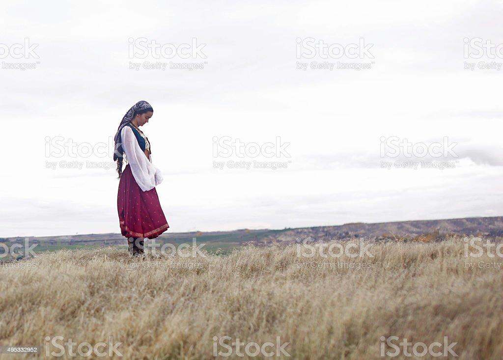 Gypsy girl praying stock photo