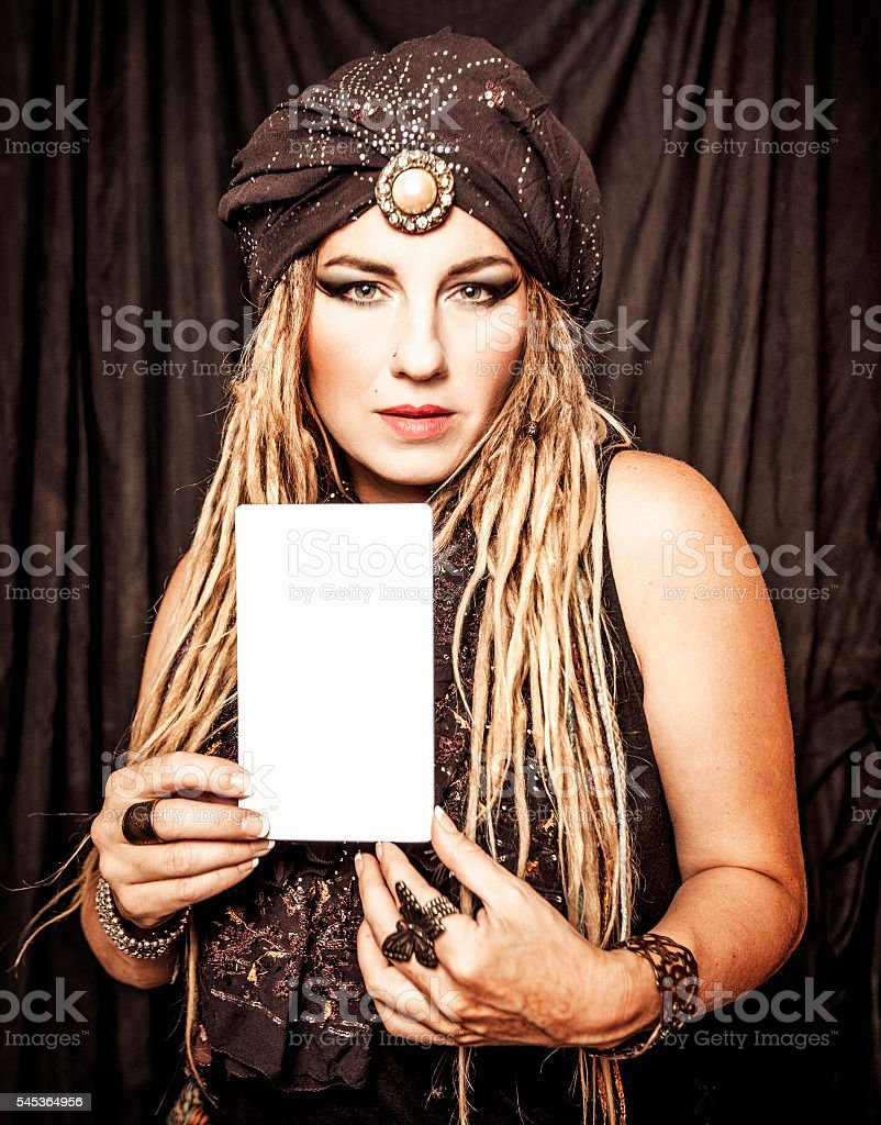 Gypsy Holding a Sign stock photo