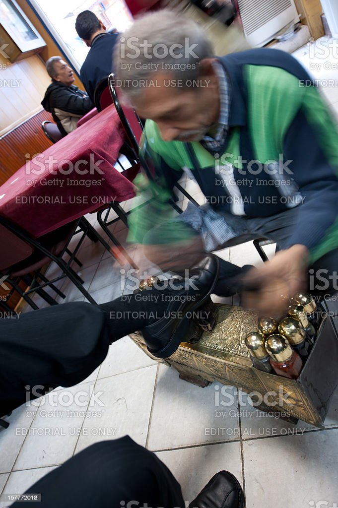 Gypsy shoe polisher working in Tarlabasi District of Istanbul, Turkey stock photo