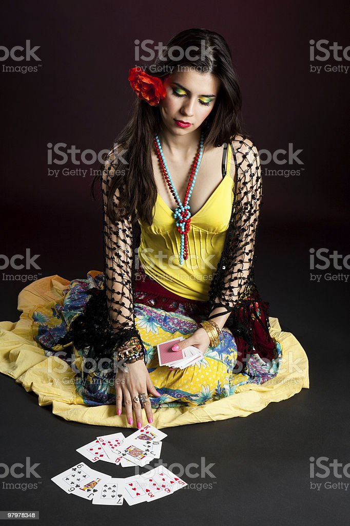 Gypsy tell fortunes by cards stock photo