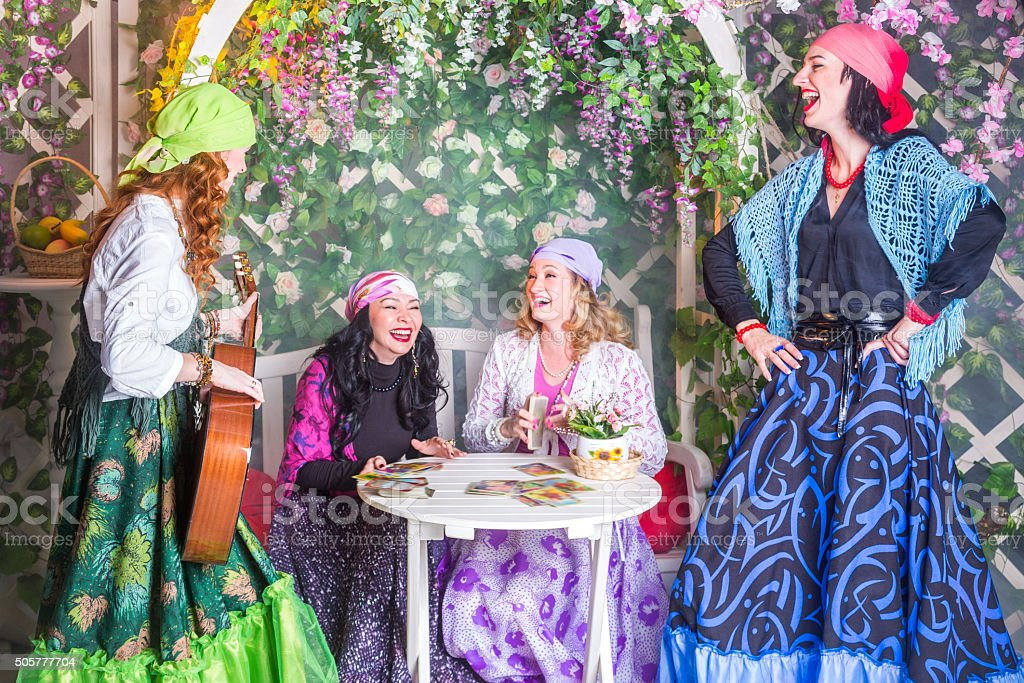 Gypsy Women Having Fun In Garden stock photo