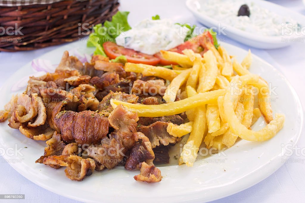 Gyros portion served on a table in a restaurant stock photo