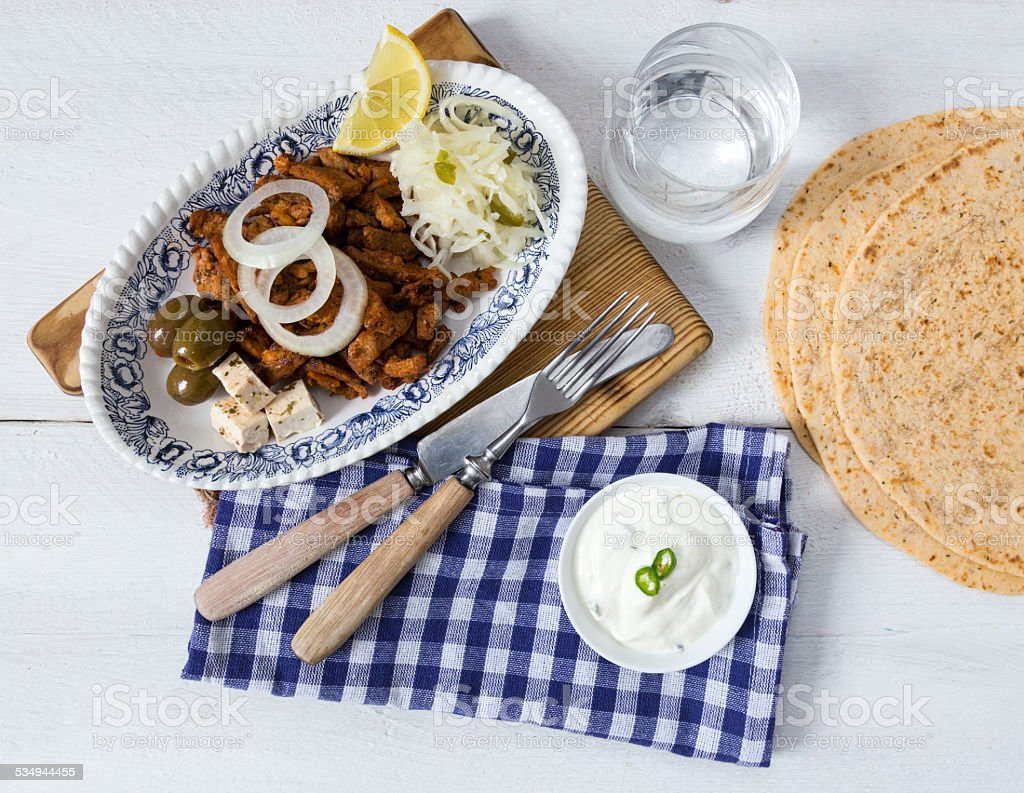 Gyros with Tzatziki Coleslaw olives and feta cheese stock photo