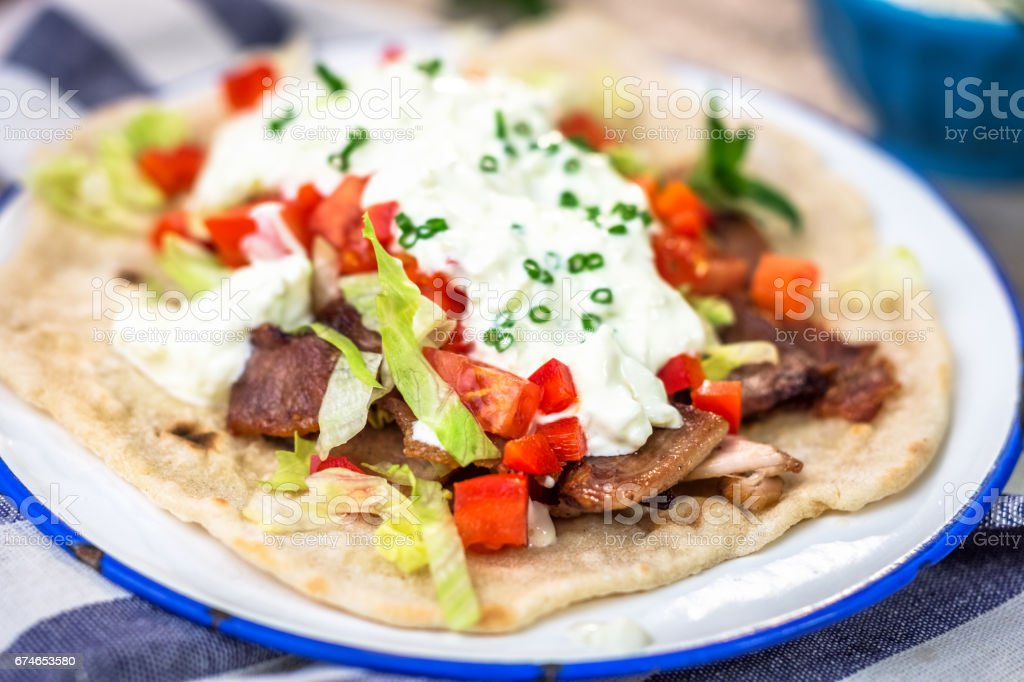 Gyros with vegetable, meat and tzatziki sauce stock photo