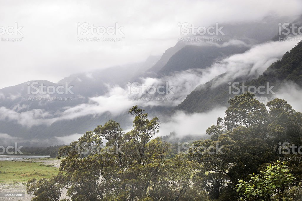 Haast Pass with fog clouds stock photo