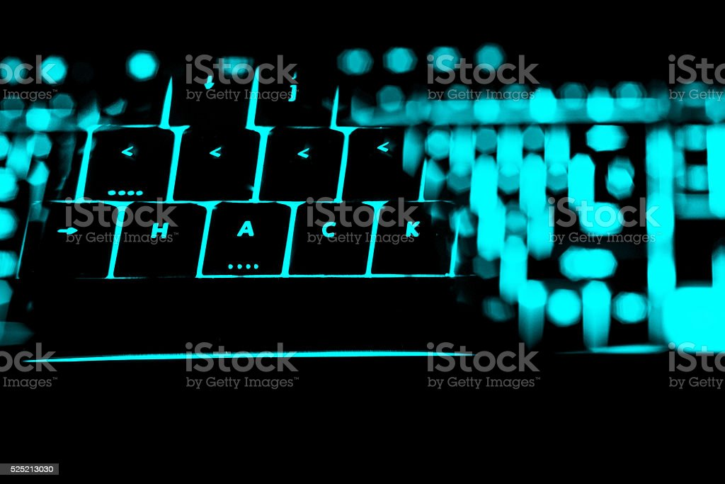 Hack text on the illuminated buttons of the keyboard stock photo