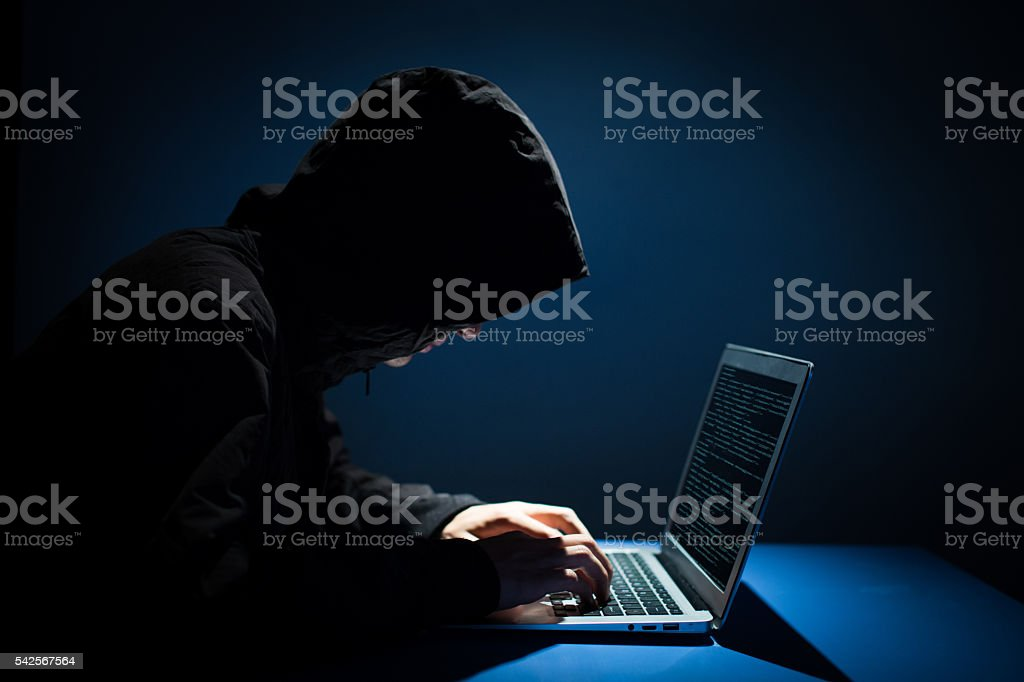 Hacker attacking stock photo
