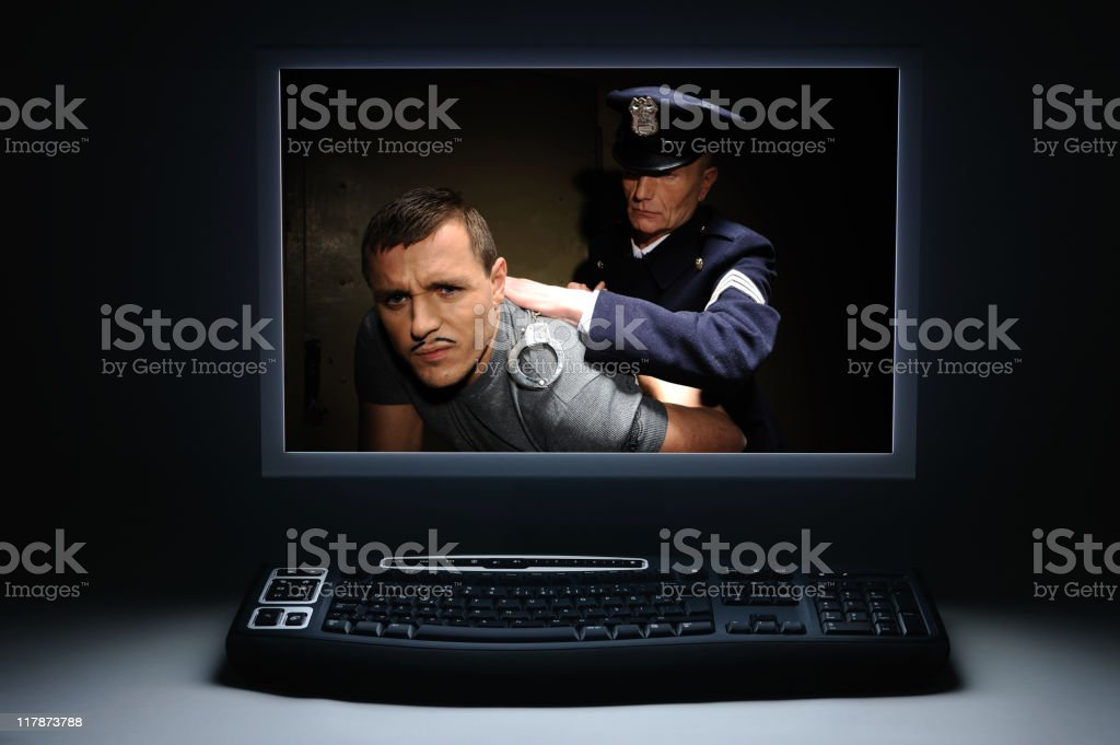 Hacker being arrested royalty-free stock photo