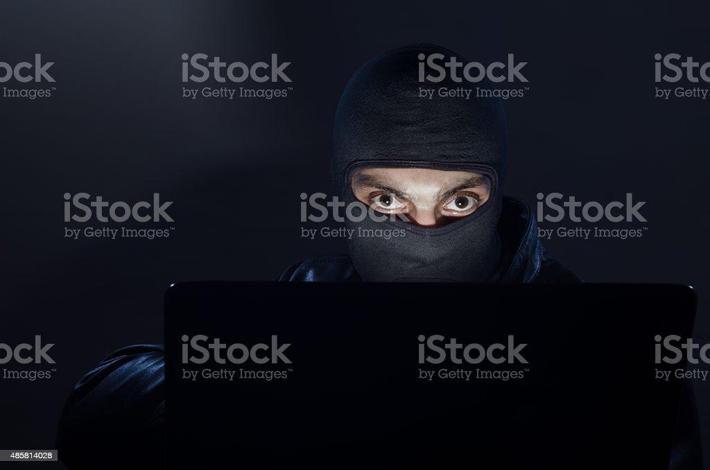 hacker, burglar, thief stock photo