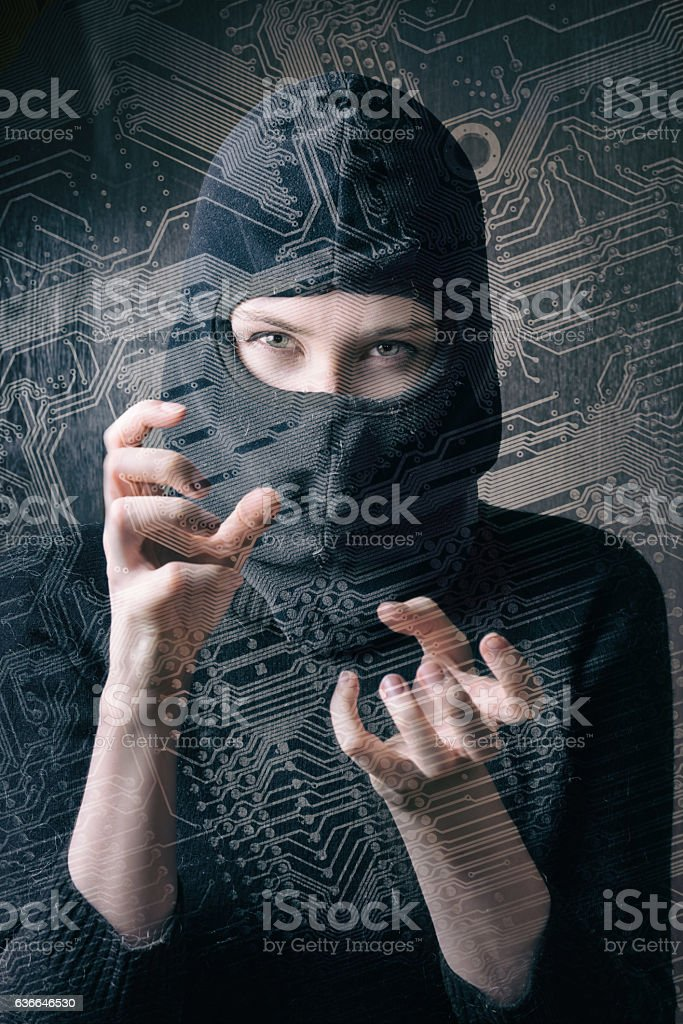 hacker girl in balaclava curled fingers makes cyber attack stock photo
