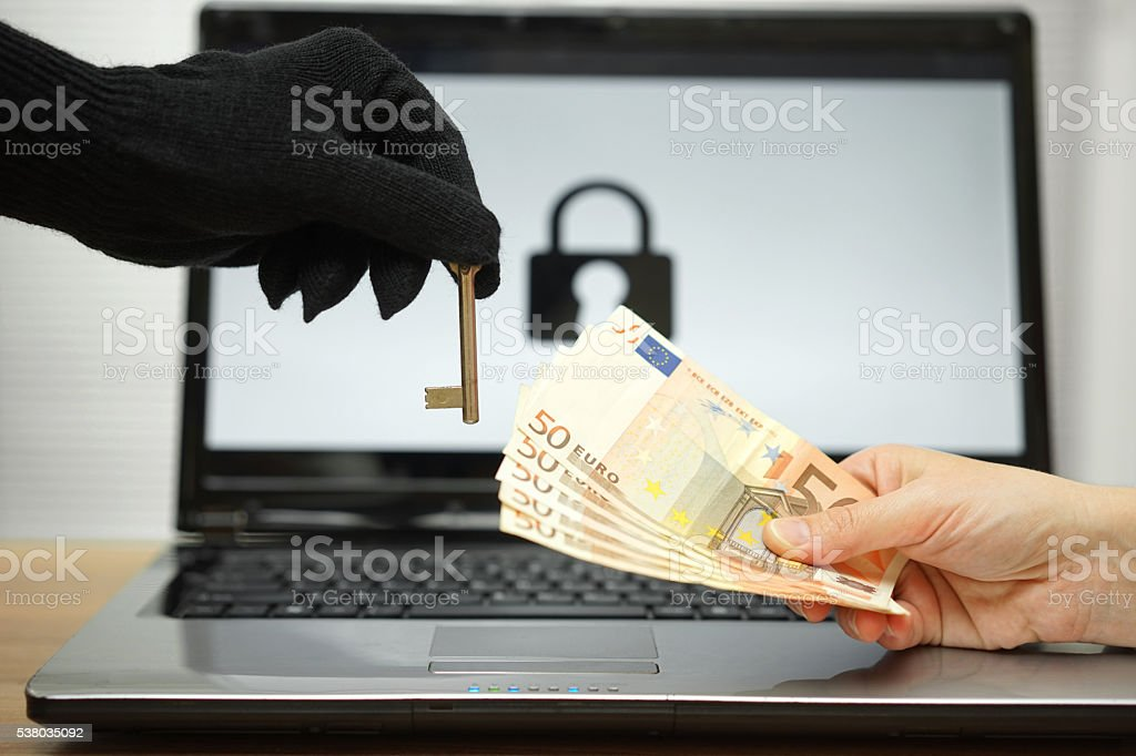 hacker gives key to victim to restore the personal data stock photo