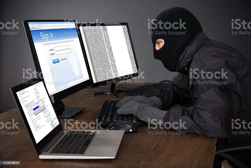 Hacker Hacking Computers stock photo