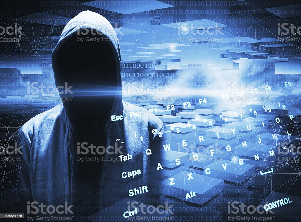 Hacker in a hood on dark blue digital background stock photo