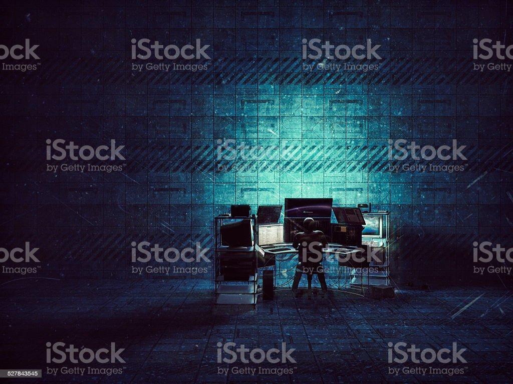 Hacker in empty warehouse, sci-fi, future, computer, crime stock photo