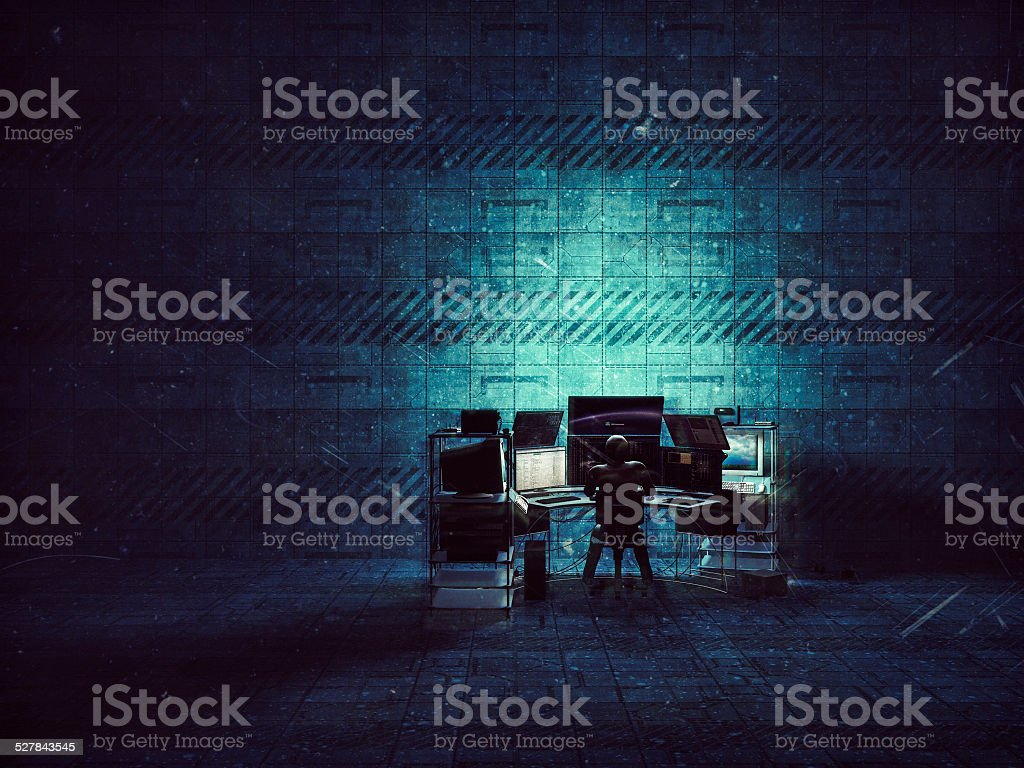 Hacker in empty warehouse, sci-fi, future, computer, crime stock photo