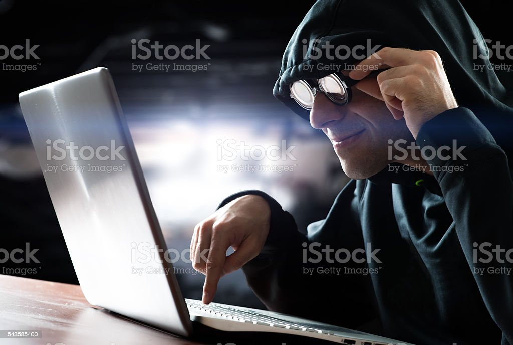 Hacker in front of his computer stock photo