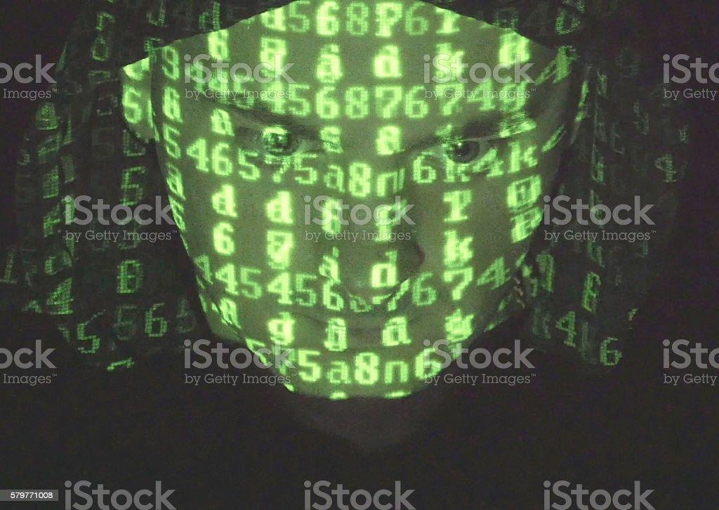 hacker in hood working on a computer foto de stock libre de derechos