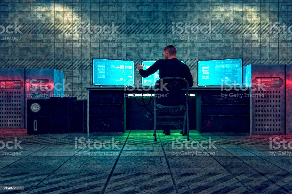 Hacker in old warehouse stock photo