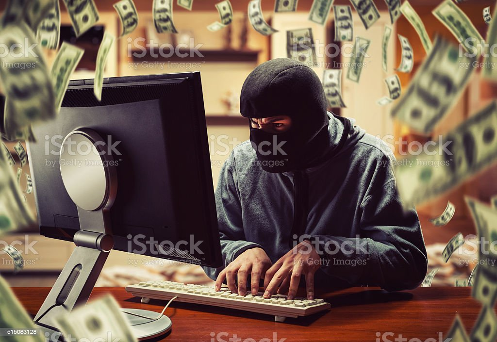 Hacker in the office stock photo