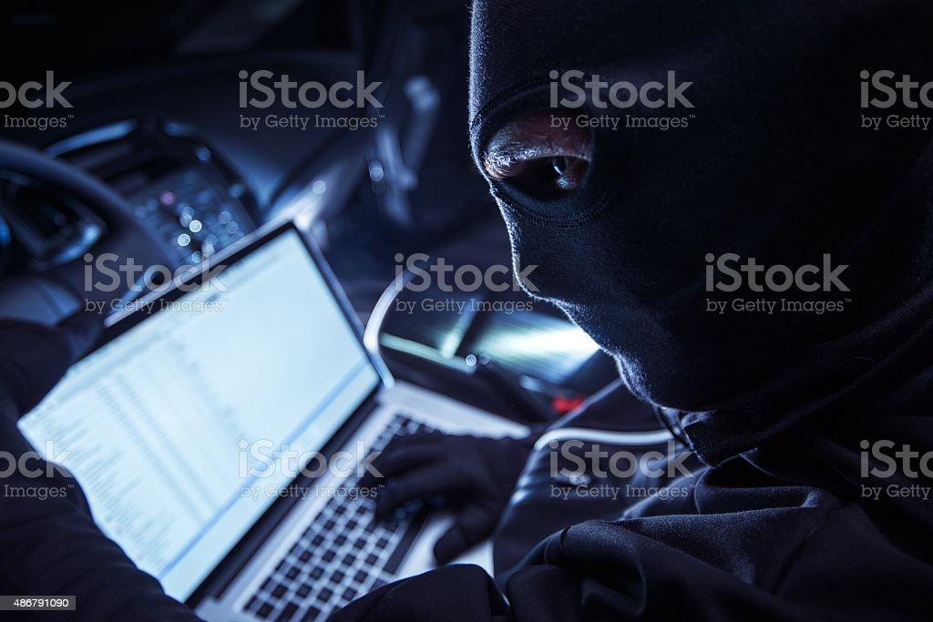 Hacker Inside the Car stock photo
