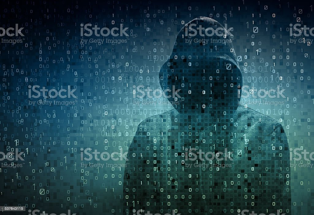 hacker over a screen with binary code stock photo