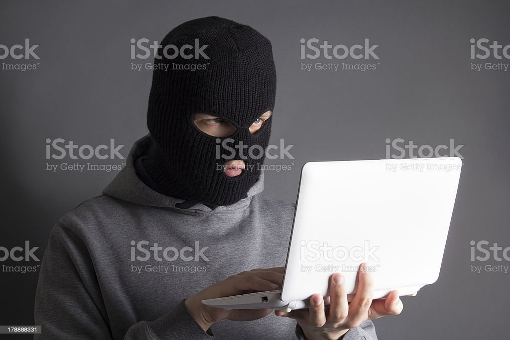 hacker stealing data from laptop over grey royalty-free stock photo
