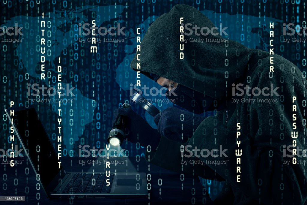 Hacker stealing information with binary code stock photo