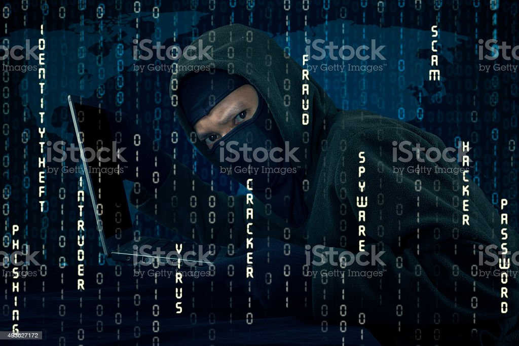 Hacker stealing laptop and breaking the security system stock photo