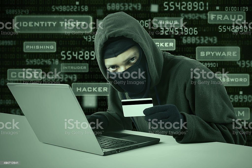 Hacker stealing online credit card stock photo