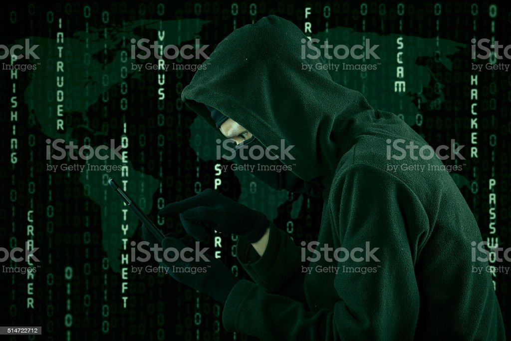 Hacker touching a smartphone screen stock photo