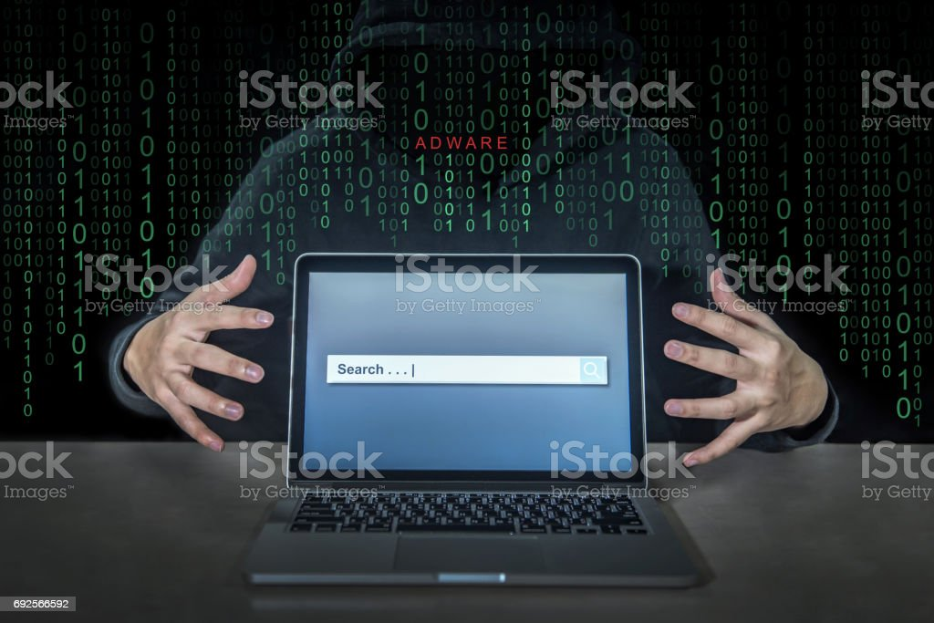Hacker using adware fireball to control laptop computer stock photo