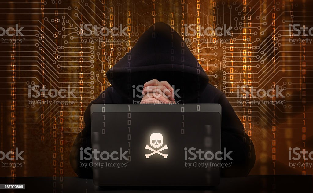 Hacker using laptop. Hacking the network. stock photo