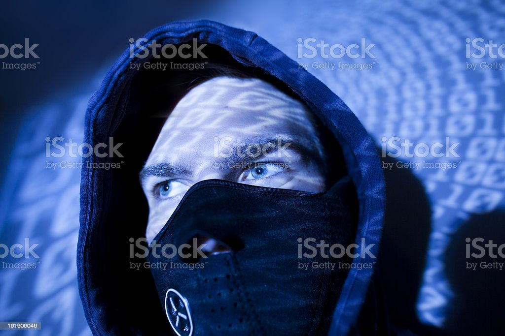 hacker with binary background royalty-free stock photo
