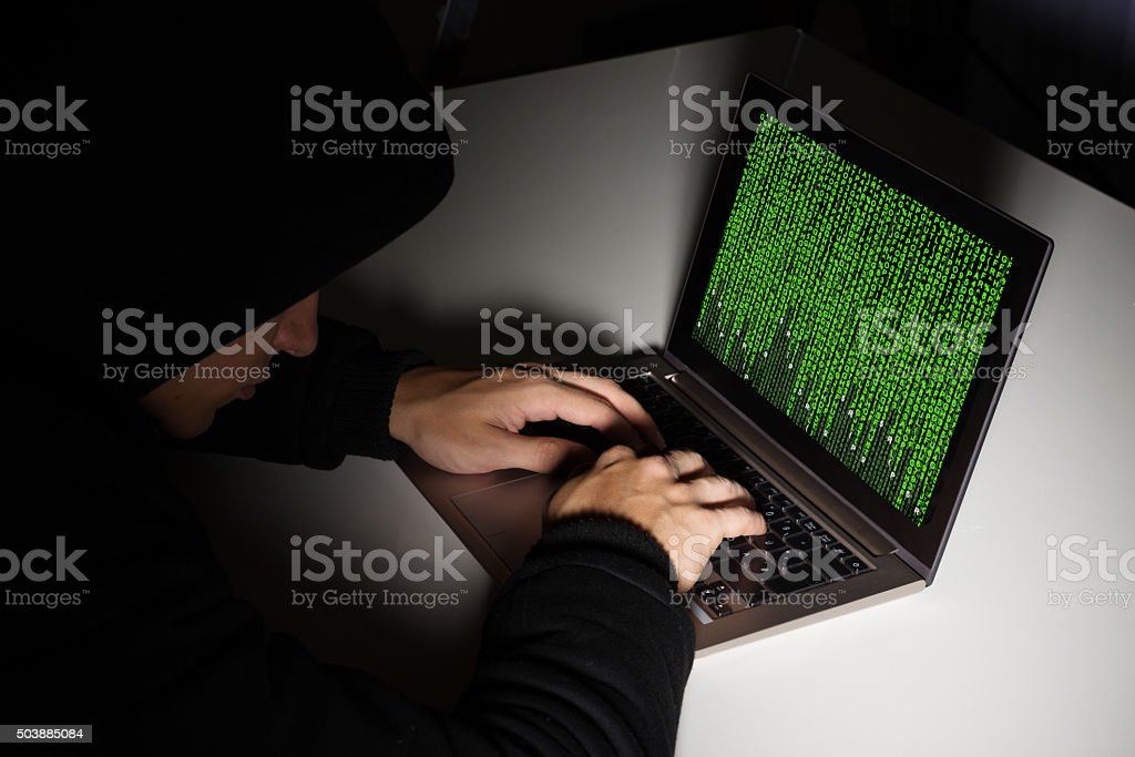 Hacker With Computers At Desk stock photo
