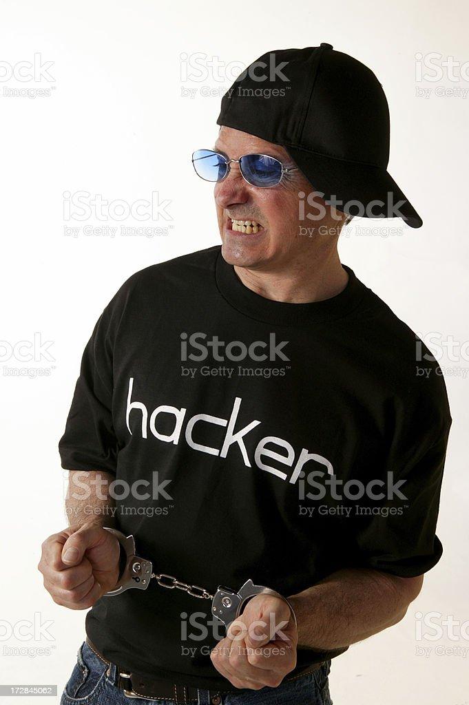 hacker with handcuff stock photo