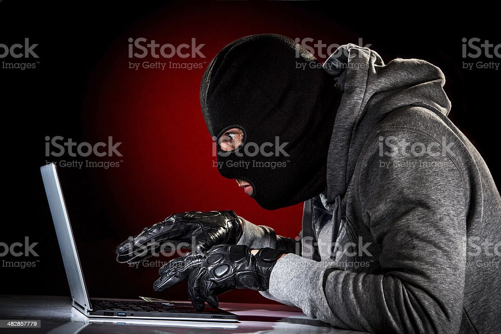 Hacker with laptop royalty-free stock photo