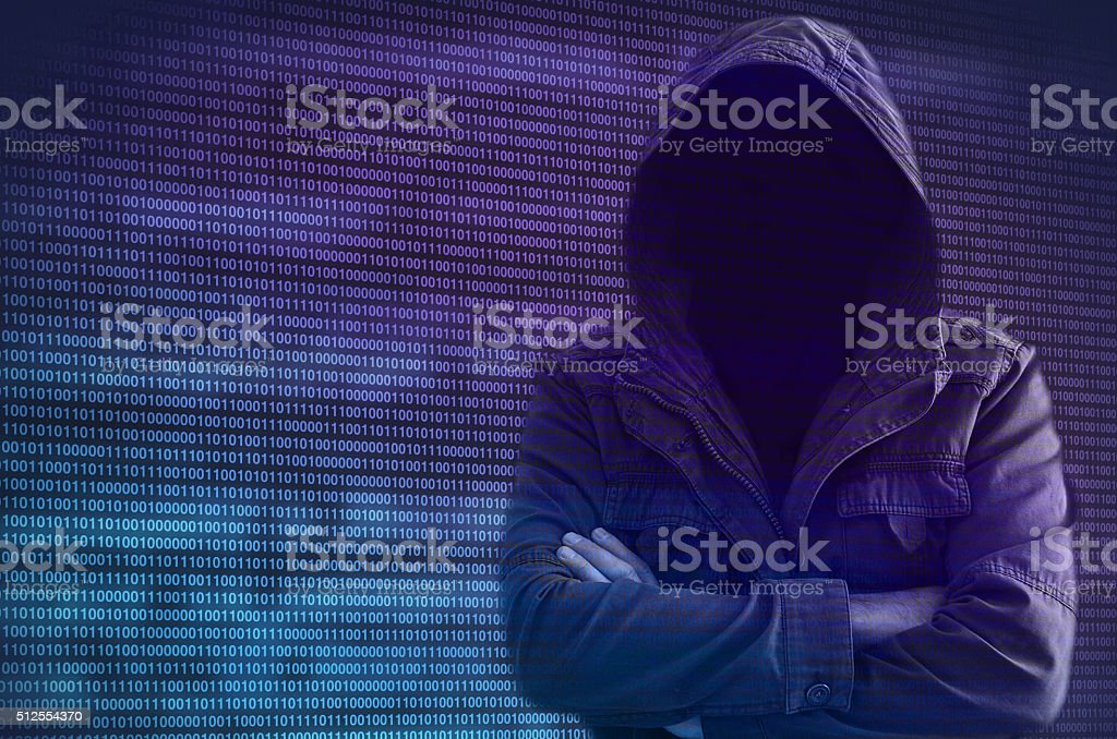 Hacker without face surrounded by binary code stock photo