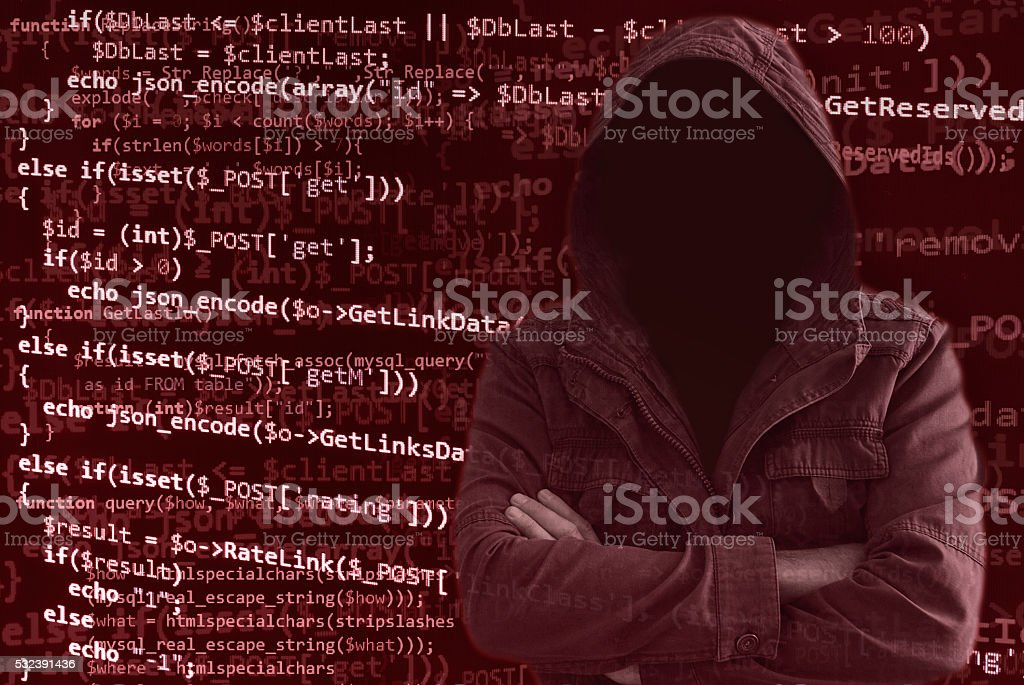 Hacker without face surrounded by programming code stock photo