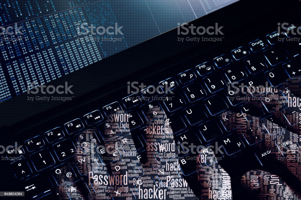 Hacker wordcloud hands at work on a laptop. first person view. stock photo
