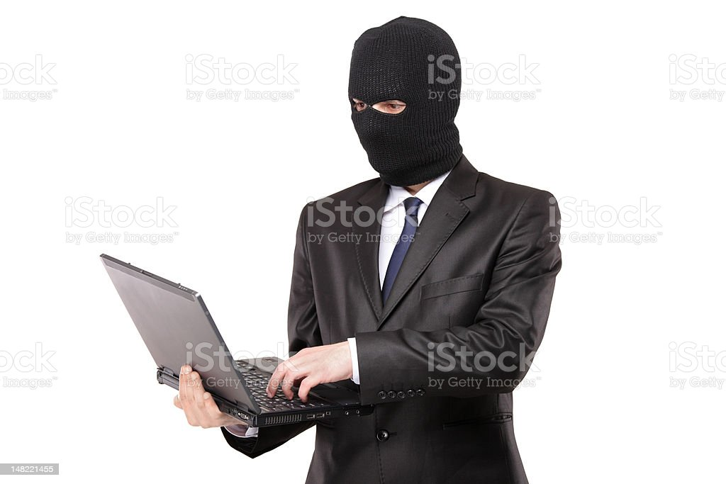 Hacker working on a laptop royalty-free stock photo
