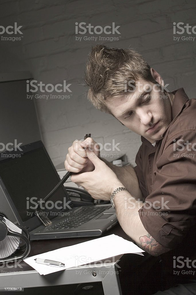 Hacking into a laptop royalty-free stock photo