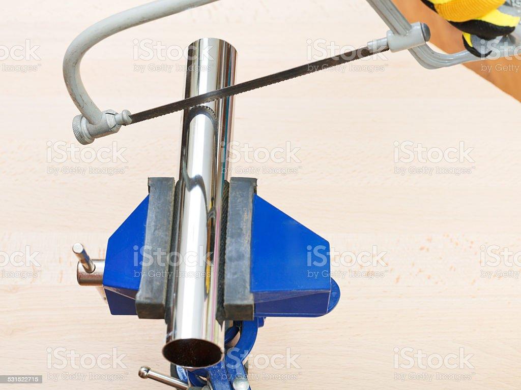 hacksaw saws chrome plated plumbing drain pipe stock photo