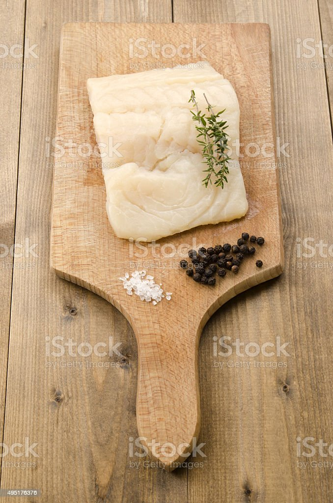 haddock fillet with thyme, coarse salt and pepper stock photo