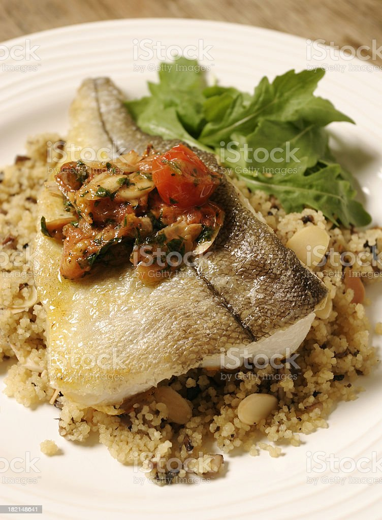 Haddock on a bed of cracked wheat stock photo