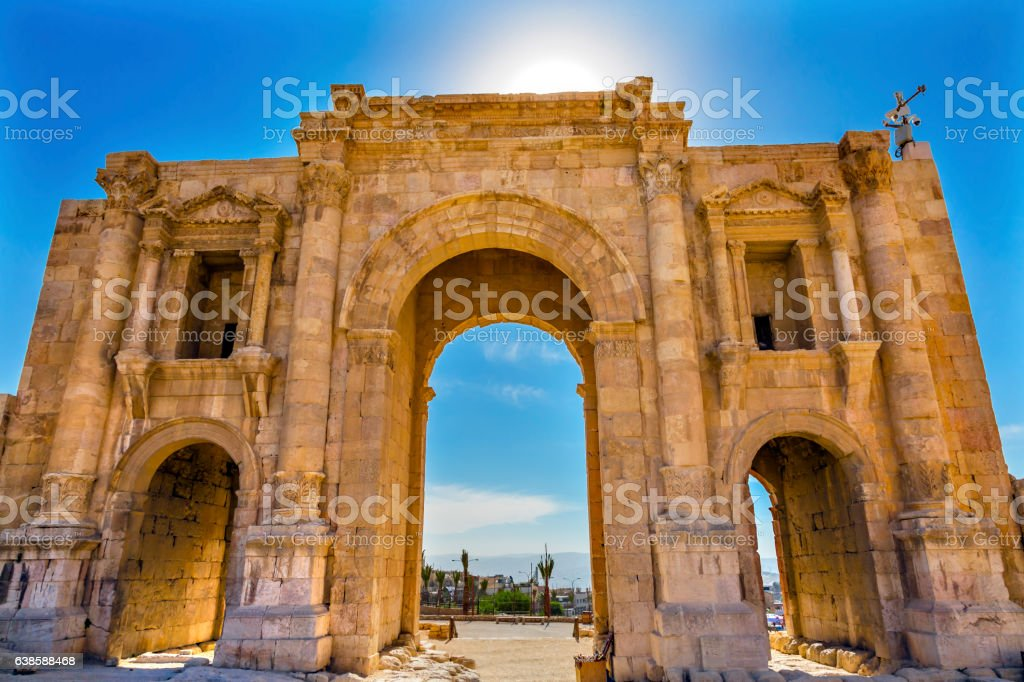 Hadrian's Arch Gate Sun Ancient Roman City Jerash Jordan stock photo