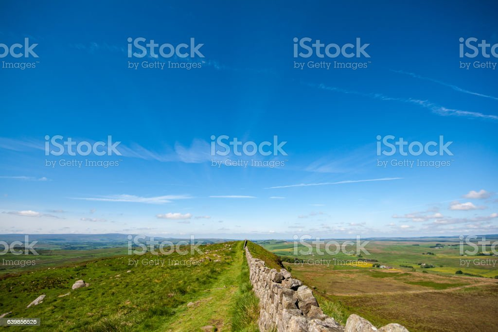 Hadrians Wall disappearing into distance of a big sky stock photo