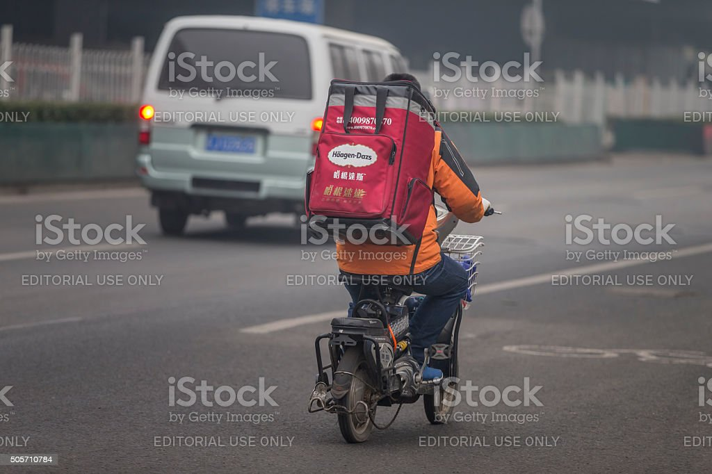 häagen-dazs ice cream delivery on an electric bicycle in Beijing stock photo