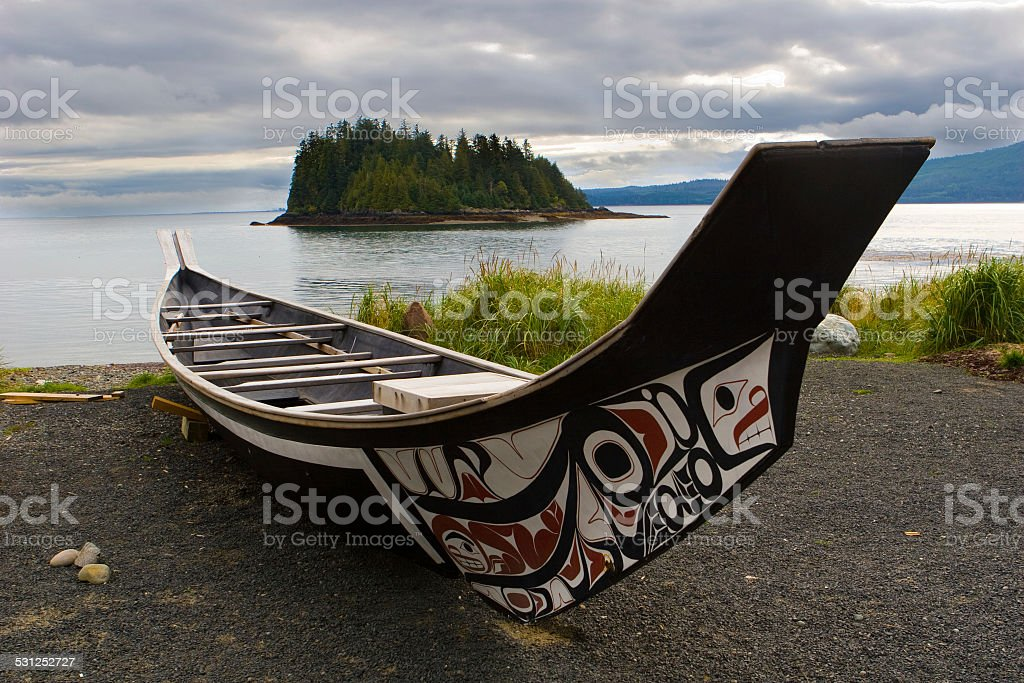 Haida Boat on the shoreline of Haida Gwaii stock photo