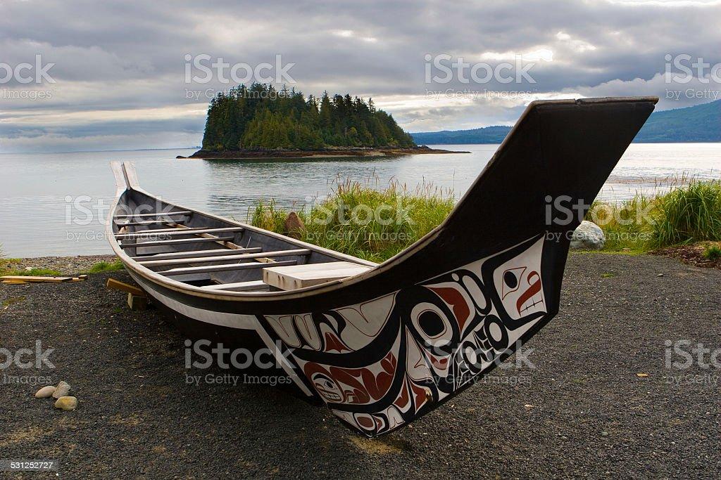 Haida Boat on the shoreline of Haida Gwaii stock photo